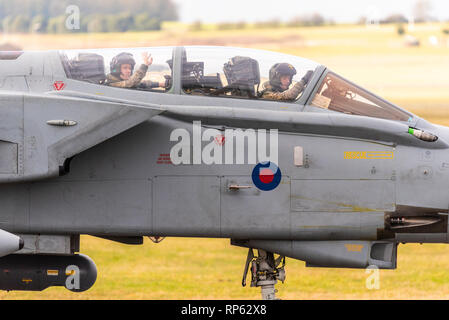 Royal Air Force Panavia Tornado Gr4 fighter jet taxiing back in after taking part in the RAF Tornado Farewell Tour titled FINale. Crew wave to fans - Stock Photo