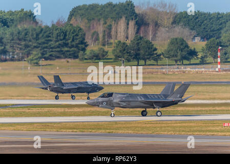 Royal Air Force RAF Lockheed Martin F-35B Lightning II stealth jet fighter plane at RAF Marham, Norfolk, UK. Pair of planes taxiing in - Stock Photo