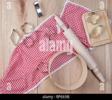 wooden kitchen items on a red towel, top view - Stock Photo