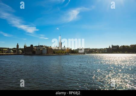 View of Stockholm skyline on Gamla Stan during a perfect blue summer day with clear sky as seen from Stockholm Stadshus (Stockholm, Sweden, Europe) - Stock Photo