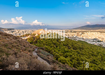View over the Athens in sunset time from Lycabettus hill, Greece. - Stock Photo
