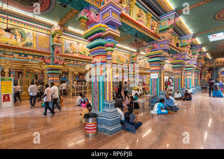 Interior view of the Arulmigu Manakula Vinayagar Temple in Pondicherry with local people visiting. - Stock Photo