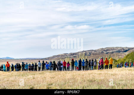 Haukadalur Valley, Iceland - September 19, 2018: Geyser landscape with back of many crowd people tourists waiting in Icelandic by Strokkur Geysir Hot  - Stock Photo