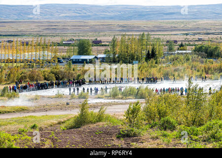 Haukadalur Valley, Iceland - September 19, 2018: Geyser high angle landscape with people tourists waiting by Strokkur Geysir eruption on Golden Circle - Stock Photo
