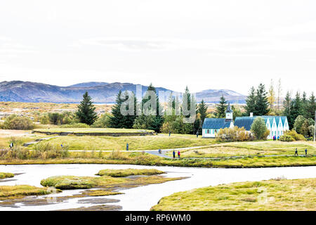 Thingvellir National Park with autumn foliage in Iceland Golden circle and farmhouse church called Thingvalla Kirkja high angle view and people on tra - Stock Photo