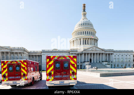 Washington DC, USA - October 12, 2018: US Congress dome construction exterior on Capital capitol hill with ambulance red fire trucks - Stock Photo