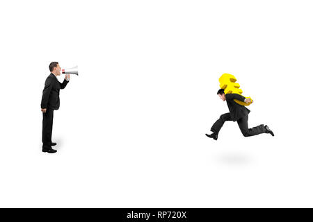 One man using speaker to direct another man carrying golden euro sign running, isolated on white background. - Stock Photo
