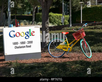 MOUNTAIN VIEW, CA, USA - AUGUST 28, 2015: close up of a sign and bicycle outside google headquarters building - Stock Photo