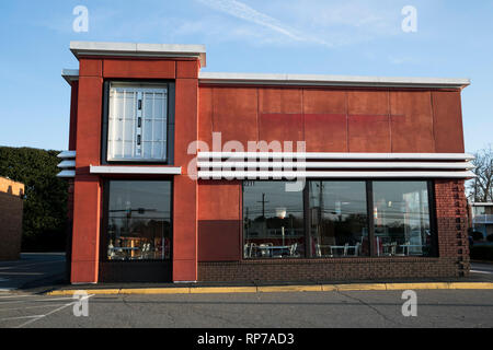 The outline of a logo sign outside of an abandoned Kentucky Fried Chicken (KFC) fast food restaurant location in Fredericksburg, Virginia on February  - Stock Photo