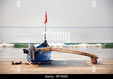 Fisherman boat on the tropical beach at Palolem beach in Goa, India - Stock Photo