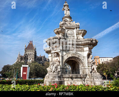 Flora Fountain and Oriental Old Building at blue sky in sunny at fort area in Mumbai, Maharashtra, India - Stock Photo