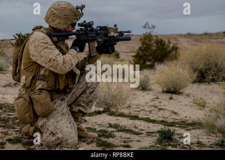 U.S. Marines with Lima Company, 3rd Battalion, 3rd Marine Regiment, execute a regimental assault course during Integrated Training Exercise 2-19 at Marine Air Ground Combat Center Twentynine Palms, California, Feb. 13, 2019. ITX prepares Marines for combat situations and provides an environment that displays unit capabilities. (U.S. Marine Corps photo by Lance Cpl. Jacob Wilson) - Stock Photo