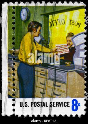USA - CIRCA 1973: A Stamp printed in USA shows the Stamp Counter, Postal Service Employees' Issue, circa 1973 - Stock Photo
