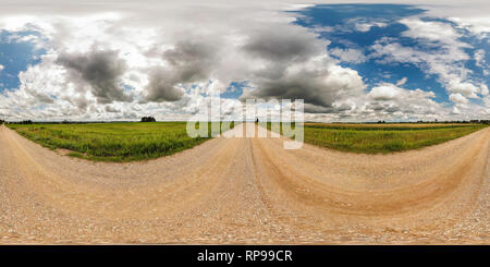 full seamless spherical panorama 360 by 180 degrees angle view on gravel road among fields in sunny summer day with awesome clouds in equirectangular  - Stock Photo