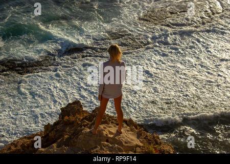 jung women standing on cliffs near port lincon at sunset, South Australia, australia - Stock Photo