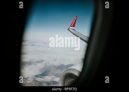 MADRID, SPAIN - October 29th, 2018: Lands and meadows of Spain, with blue sky on top and white clouds,  viewed from a Norwegian Airlines plane, during - Stock Photo