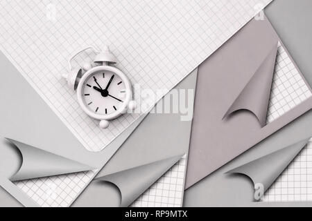 School notebooks and alarm clock, flat lay. Top view. Concept of of starting school, back to school, education - Stock Photo
