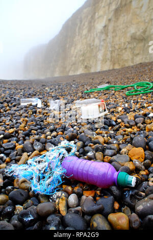 Plastic washed up on a pebble beach, Newhaven, East Sussex. - Stock Photo