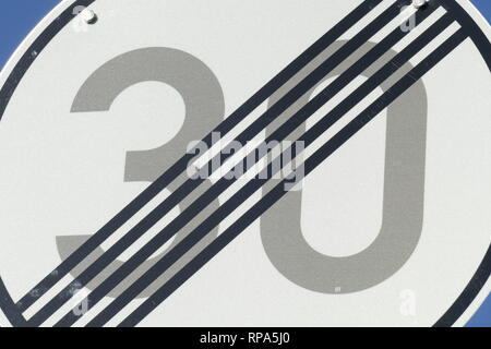 Road sign at the end of a Tempo 30 zone - Stock Photo