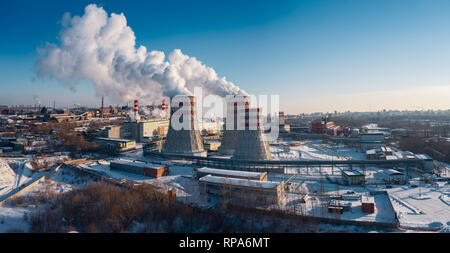 Panoramic view of heavy industry with detrimental impact on nature; CO2 emissions, toxic poisonous gases from chimneys; rusty dirty pipelines and clou Stock Photo