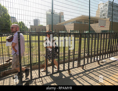 Beijing, China. 26th July, 2018. An American family leaves the U.S. Embassy after a small 'bomb' was set-off in the intersection near the embassy in Beijing on July 26, 2018. A 26-year-old man from Inner Mongolia detonated a small explosive on the street, police said, injuring himself before being taken into custody. News of the incident was quickly censored on Chinese social media. Credit: Todd Lee/ZUMAprilESS.com/ZUMA Wire/Alamy Live News - Stock Photo