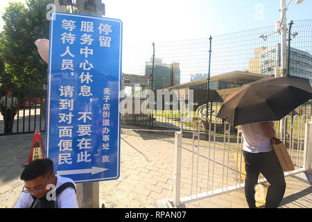 Beijing, China. 26th July, 2018. Chinese wait for the U.S. Embassy to repoen after a small 'bomb' was set-off in the intersection near the embassy in Beijing on July 26, 2018. A 26-year-old man from Inner Mongolia detonated a small explosive on the street, police said, injuring himself before being taken into custody. News of the incident was quickly censored on Chinese social media. Credit: Todd Lee/ZUMAprilESS.com/ZUMA Wire/Alamy Live News - Stock Photo
