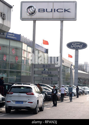 April 8, 2018 - Beijing, China - Chinese national flags fly over Ford and Buick showrooms in Beijing on April 8, 2018.  China hit back at the U.S. with proposed tariffs on $50 billion worth of goods - American cars, soybeans, whiskey and other goods.. (Credit Image: © Todd Lee/ZUMAprilESS.com/ZUMA Wire)