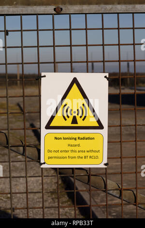 Non ionising radiation warning sign outside a BT microwave transmitter station - Stock Photo