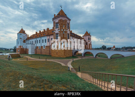 Mir Castle in Belarus cultural heritage and architecture, summer landscape with a cloudy sky - Stock Photo