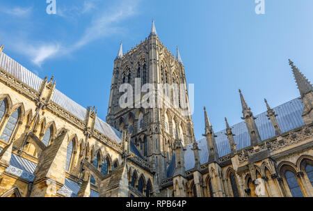 Gothic architecture of Lincoln Cathedral in the city of Lincoln, Lincolnshire, East Midlands, England, UK on a fine sunny day with blue sky - Stock Photo