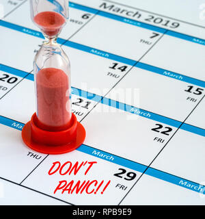 Concept image of time running out, or running down the clock to Brexit day deadline on 29th March 2019 shown by a calendar and hourglass timer. - Stock Photo