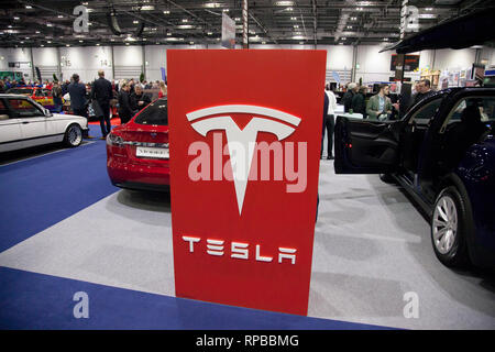 LONDON, UK - FEBRUARY 15th 2019: Tesla car brand on show at the Classic car show - Stock Photo