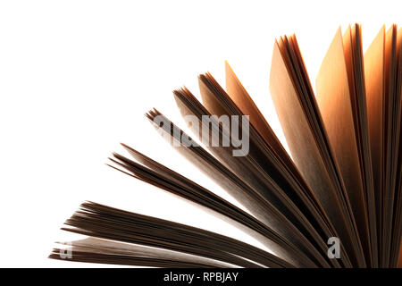 Education and reading concept. Sheets of book full of mysteries, stories and plots on black background. Isolated on white - Stock Photo
