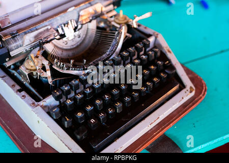 07fba94b819 ... Old fashion typewritter on blue wooden background. Close up of vintage  russian typewritter machine with