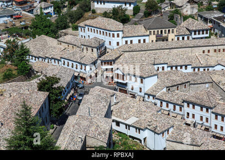 Stone roofs of the town Gjirokaster, city in southern Albania - Stock Photo