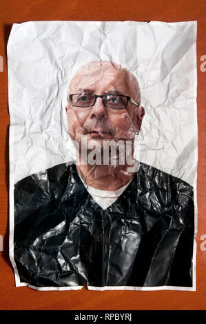 portrait photo of a bald man with eyeglasses crumpled and wrinkled, ageing concept
