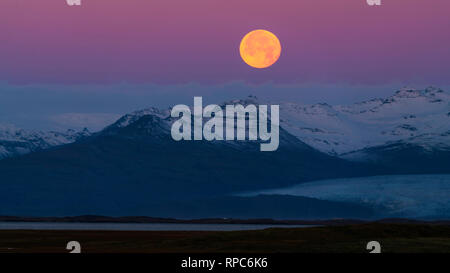 Beautiful landscape at Stokksnes, a moonset in the colors of sunrise - Stock Photo