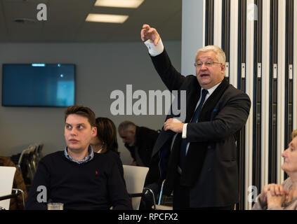 Auderghem, Brussels / Belgium - 02 18 2019: Brussels minister-president Guy Vanhengel talking in a boarding room of the CHIREC hospital - Stock Photo