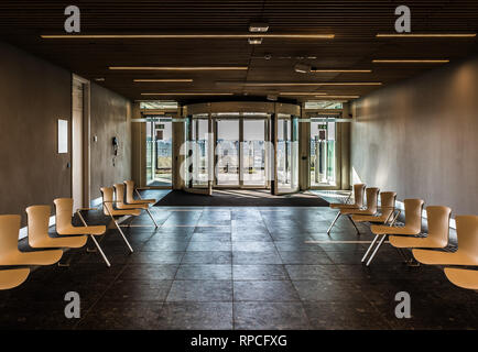 Auderghem, Brussels / Belgium - 02 18 2019: Hardboard chairs in an empty waiting room at the CHIREC hospital - Stock Photo