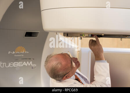 Auderghem, Brussels / Belgium - 02 18 2019: Doctor checking cancer therapy equipment with radiation threatment in the CHIREC hospital - Stock Photo