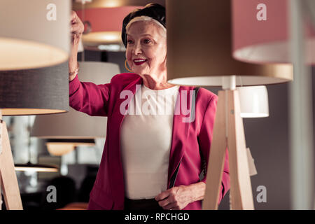 Close-up of fancy seventy-year madam wearing voguish leather beret - Stock Photo
