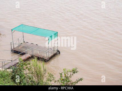 Small pontoon is floating on the large river for the local people,northern of Thailand. - Stock Photo