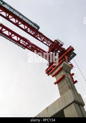 Girder launcher on the concrete pillar for construction the train bridge of the metro rapid transportation in Bangkok,Thailand - Stock Photo