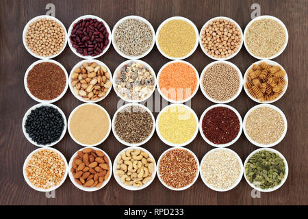 Dried vegan health food with  grains, nuts, seeds, sos mix, cereals, wholegrain pasta and legumes. - Stock Photo
