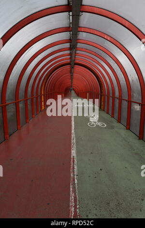 A famous Glasgow landmark. The elevated tunnel walk and cycle path which leads to the entrance of the SECC. - Stock Photo