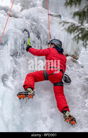 Munising, Michigan - A boy climbs an ice wall during the annual Michigan Ice Fest. Participants climbed frozen ice formations in Pictured Rocks Nation - Stock Photo