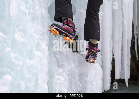 Munising, Michigan - Participants used crampons to climb frozen ice formations in Pictured Rocks National Lakeshore during the annual Michigan Ice Fes - Stock Photo