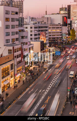 Bird's view of the Japanese youth culture fashion's district crossing intersection of Harajuku Laforet named champs-élysées in Tokyo, Japan at sunset. - Stock Photo