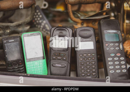 Old and obsolete mobile phone or cell phones on space of old wood background - Image - Stock Photo