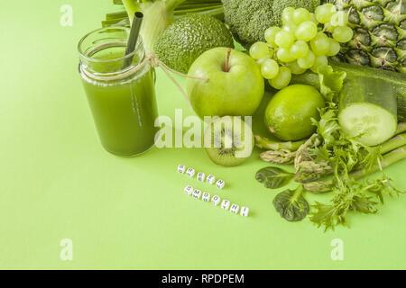 Green health smoothie fruits and vegetables, kale leaves, lime, apple, kiwi, grapes, banana, avocado, lettuce pineapple salat. Copy space. Raw, vegan - Stock Photo